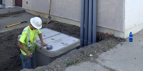 Anderson Underground employee using fiber pulling and blowing methods to install cable
